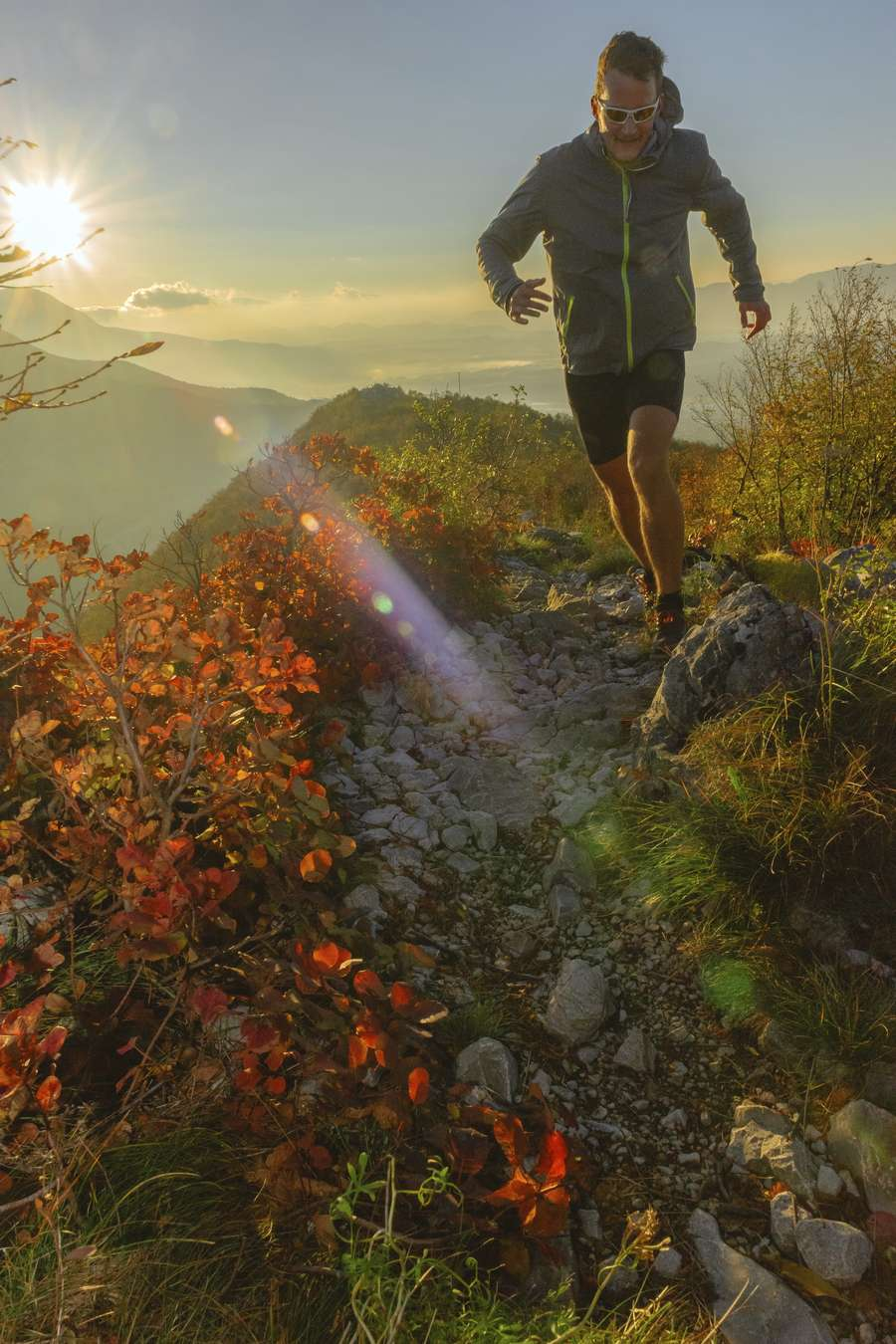 Young runner running  in the morning on the mountain,red smokebush,lens flare, Sabotin, Nova Gorica,Primorska, Slovenia, High ISO,Nikon D3x