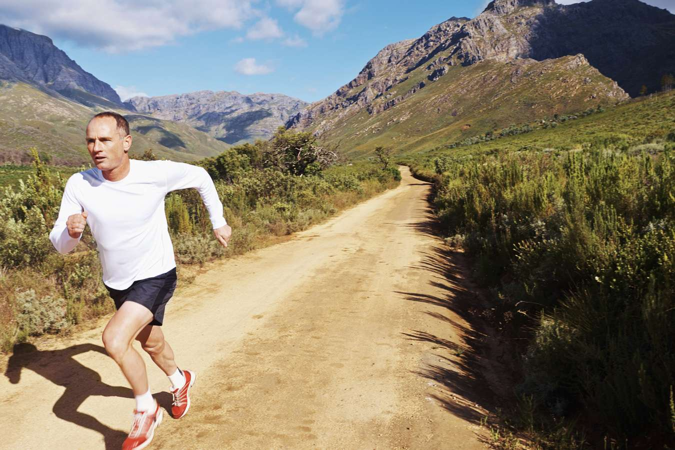 Full-length shot of a mature man running outdoors